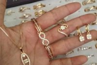 kode huruf perhiasan emas
